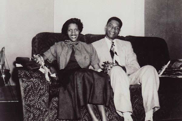 Medgar Evers and Myrlie Evers sitting on their couch